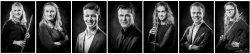 Portretten van zeven musici in zwartwit