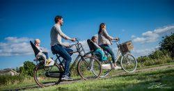 Reclame fotografie: een gelukkig gezien op de fiets