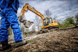 Bouw fotograaf - het afgraven van vervuilde grond