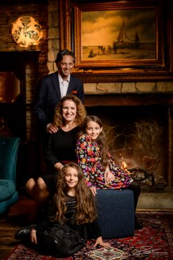 Family portrait by the fireplace